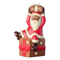 300 g św. Mikołaj siedzący na prezencie z mlecznej czekolady 65469 CCW